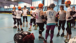 Dazey Girl #814 and Mother of Anarchy discuss strategy with their lineups before starting the scrimmage.
