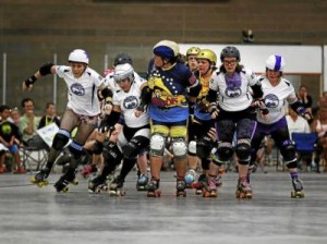 Amy Jo Moore eyes the Pair O'Dice jammer from the front of the pack