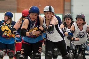 Roxy Slaughter pushes past the Albany pivot